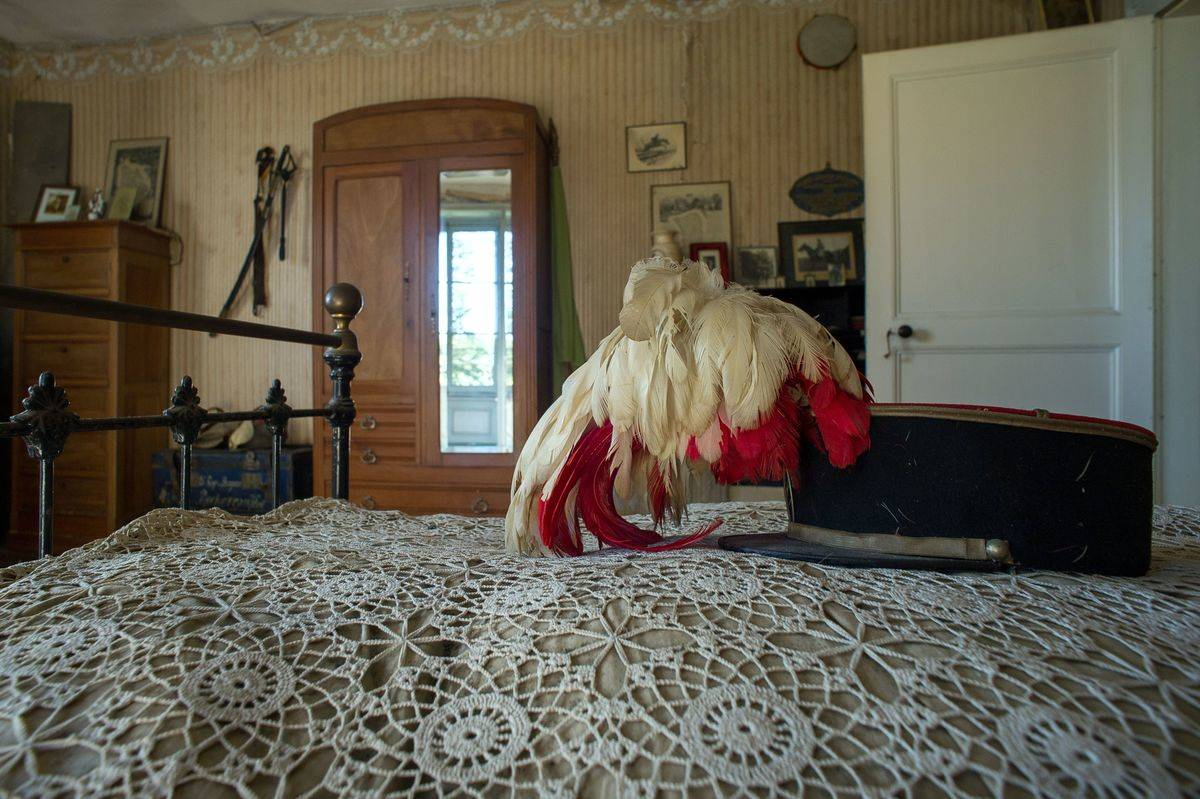 Hubert Rochereau's feathered military hat lies at the end of his bed.