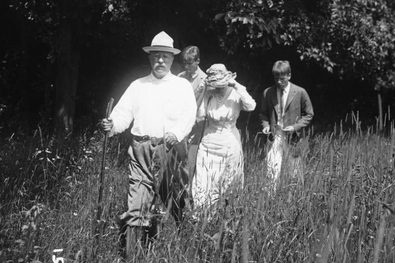 President Theodore Roosevelt hikes with his family.