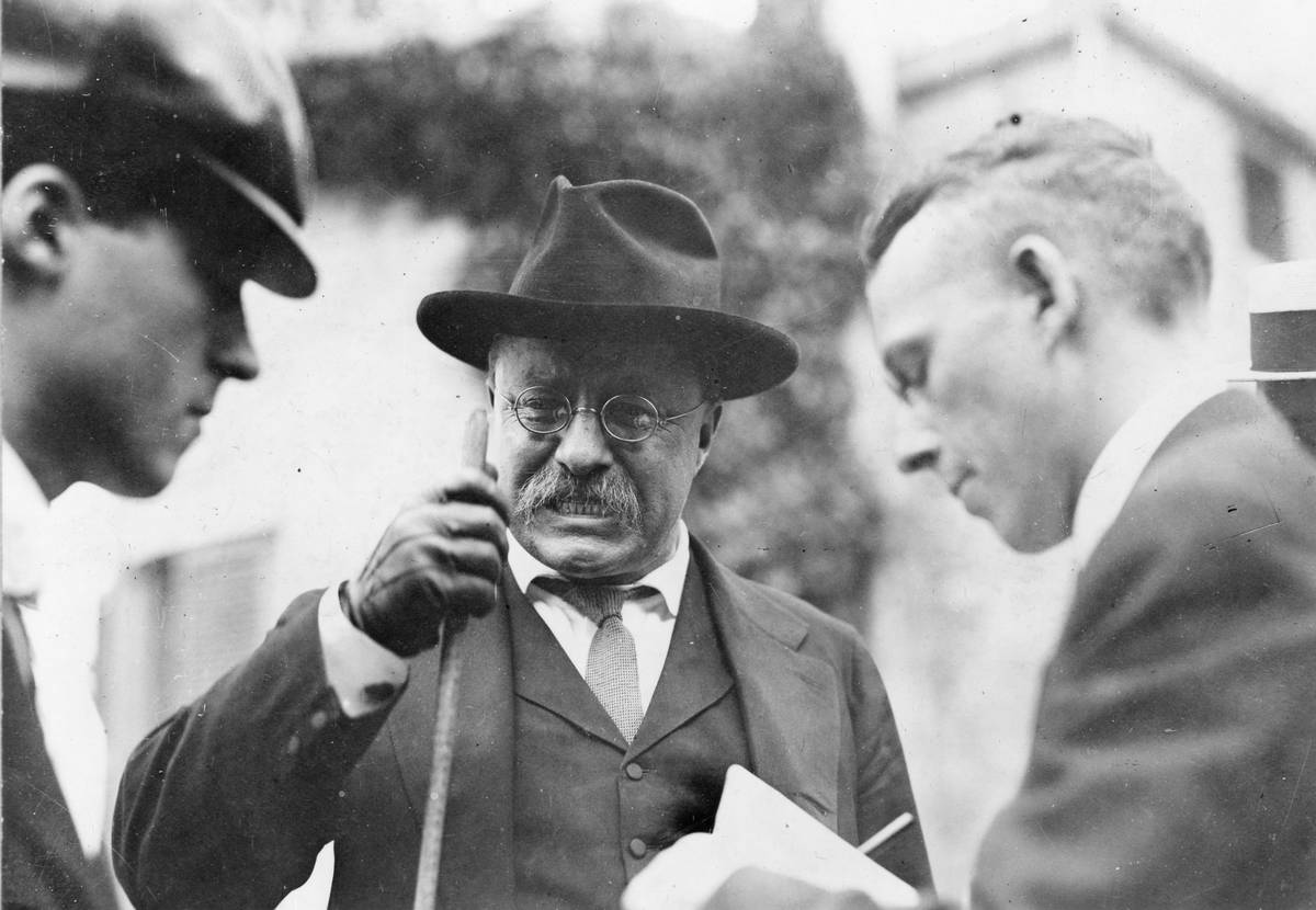 Theodore Roosevelt speaks to the press in the early 1900s.