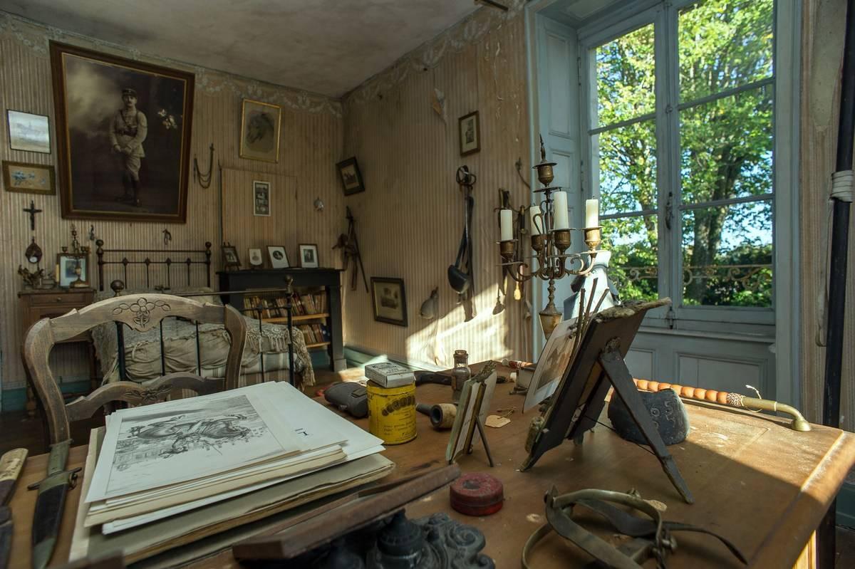 Hubert Rochereau's room is seen from behind his desk.