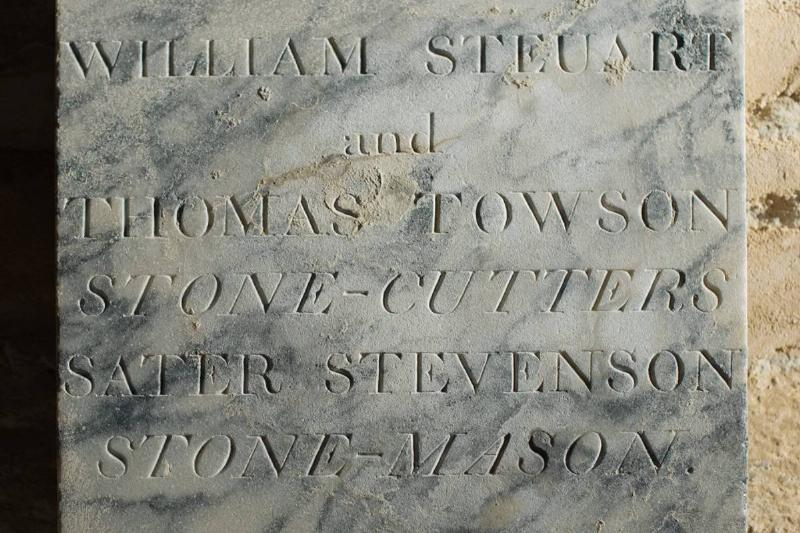 A stone plaque includes the names of all stone cutters who contributed to the time capsule.