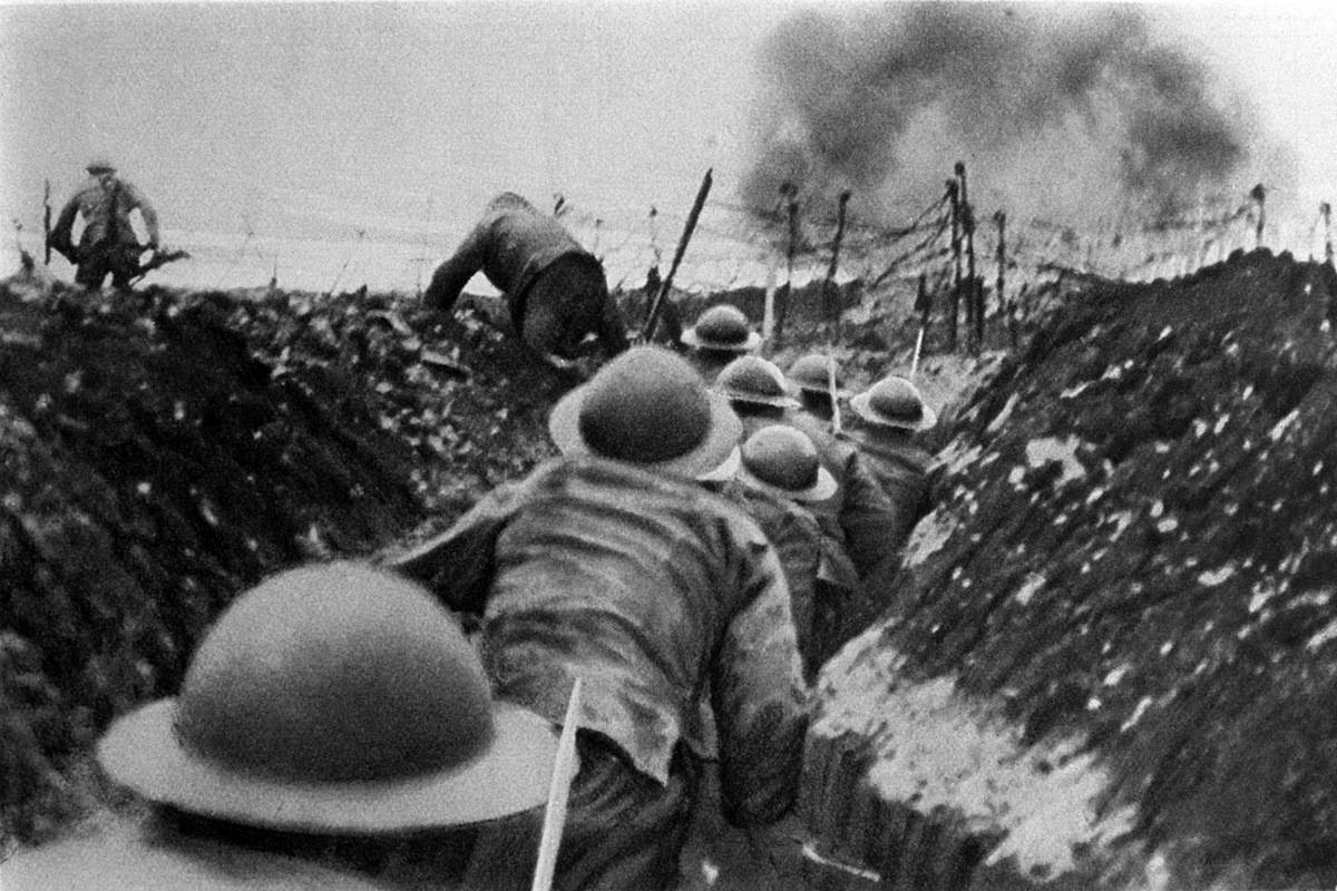 English and French soldiers crawl through the trenches during a World War I battle.