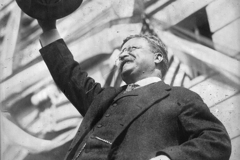Theodore Roosevelt waves to the crowd after becoming the 26th president.
