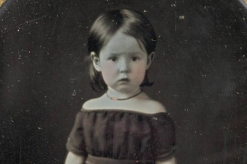 A young girl is photographed between the 1840s and 1850s.