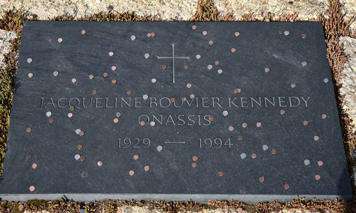 Coins are on top of Jackie Kennedy's grave.
