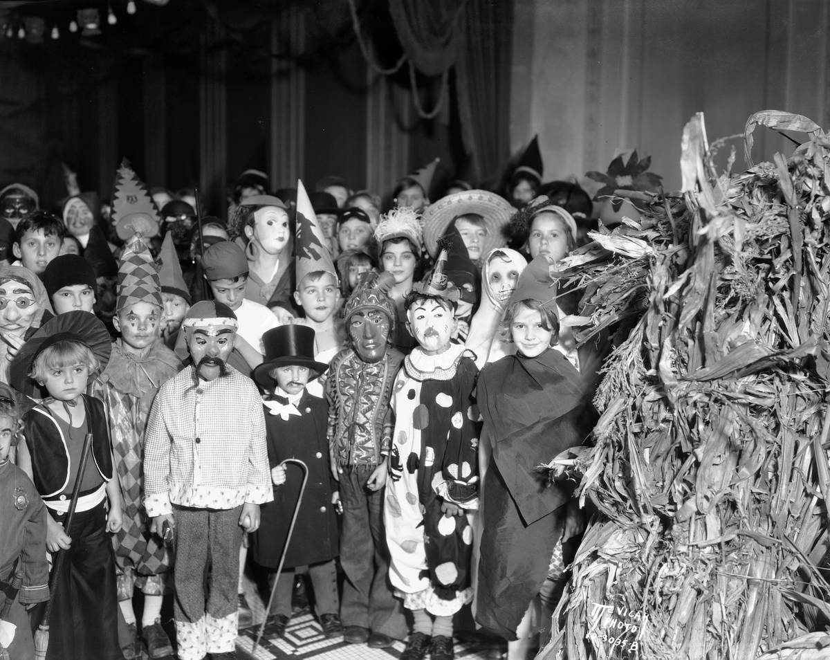A group of school children pose for the camera wearing their Halloween costumes