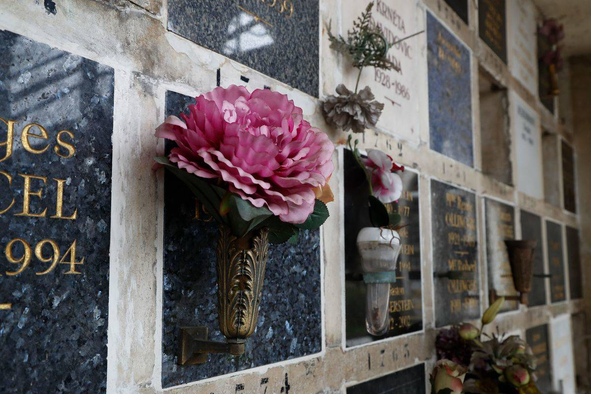 Flowers are laid on funeral urns in the Pere Lachaise cemetery.