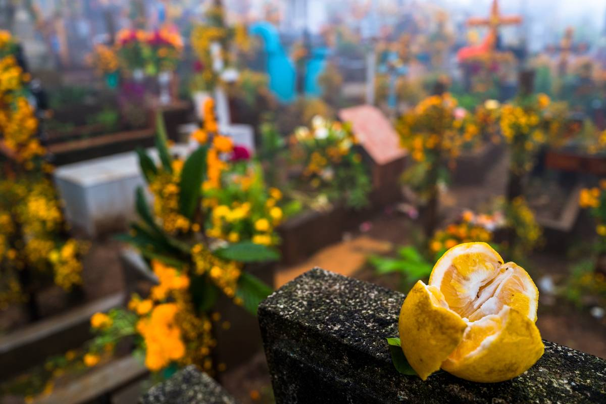 A lemon was placed on top of a headstone in a cemetery during the Day of the Dead.