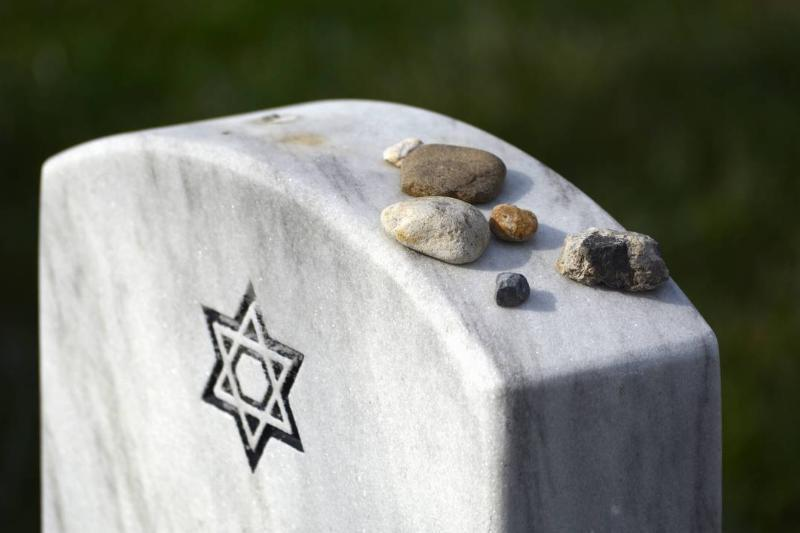 Rockers have been placed on top of a Jewish headstone.