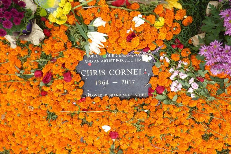 Dozens of flowers in a variety of colors surround Chris Cornell's grave.