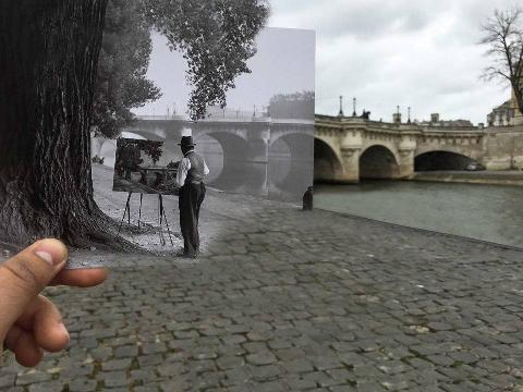 Old picture being held up in the exact place that it was originally taken in Paris