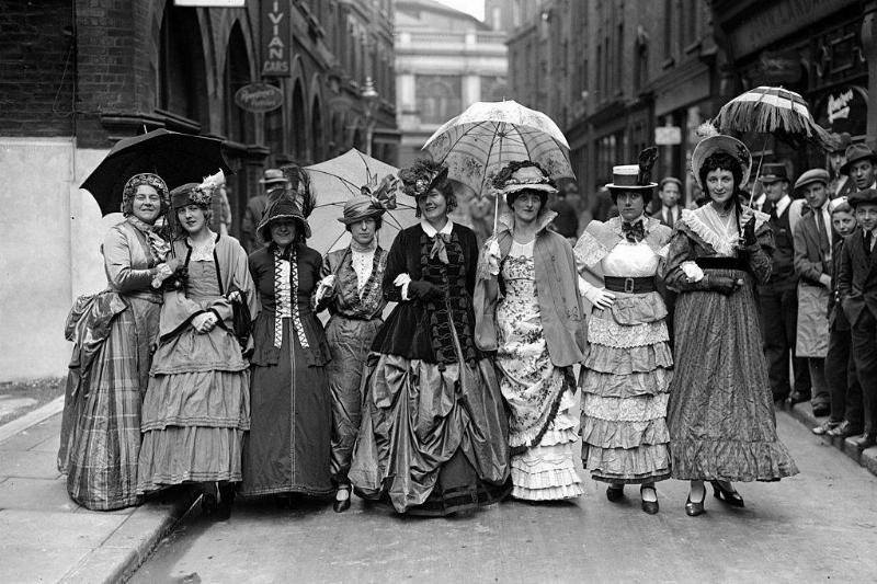 A group of women dressed in Victorian style clothing