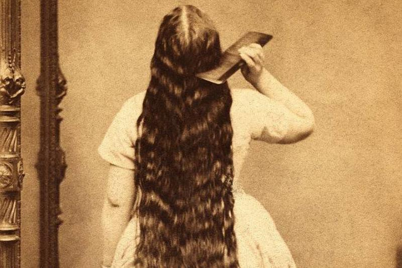 woman with long hair during the victorian age