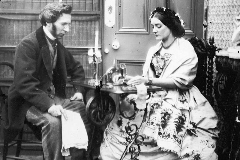 A Victorian couple with a sewing machine, circa 1855